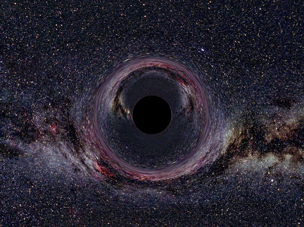 A simulação de um buraco negro contra o fundo da Via Láctea.