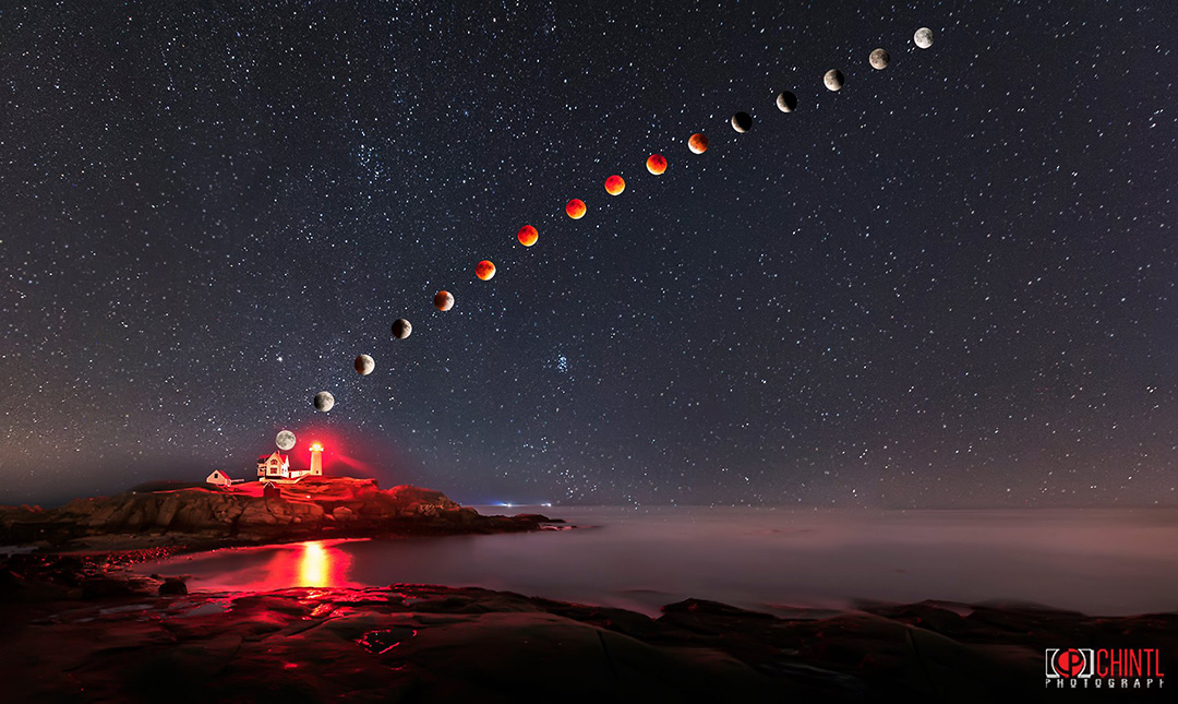 Lunar Eclipse This is a composite image, the foreground was shot at 14MM and the Moon was shot with 400mm. This image was captured at Nubble light house on Sep 27th from 8PM EST to 12:45Am. -  Sashikanth Chintla Photography